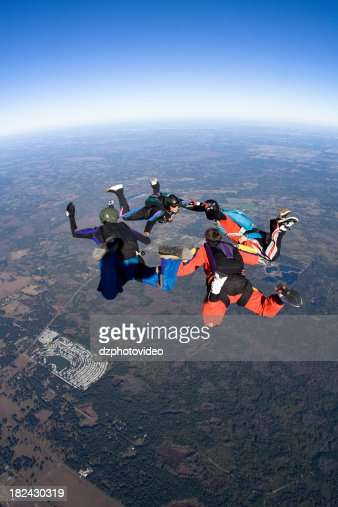 Royalty Free Stock Photo: Four Skydivers in Freefall Formation