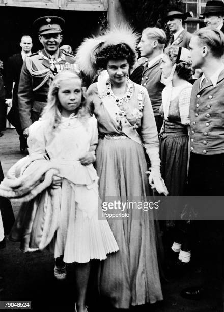 circa 1940's Queen Friederika born 1917 pictured with her daughter Princess Sophia with King Paul behind Queen Friederika of German descent married...