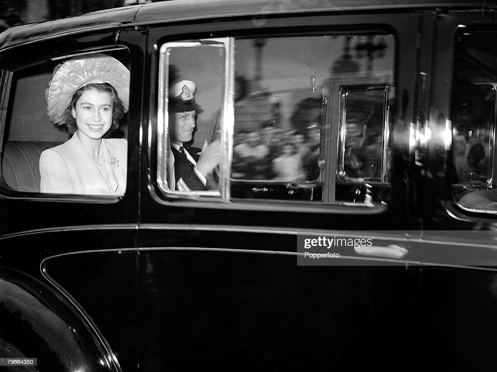 Royalty, London, England, 10th July, 1947, Princess Elizabeth (later Queen Elizabeth II) and Lieutenant Philip Mountbatten leave Buckingham Palace in a car after the announcement of their engagement