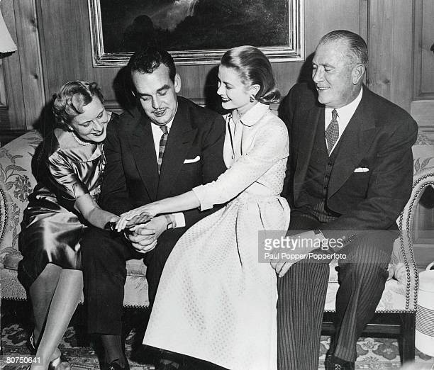 Royalty Philadelphia USA 10th January 1956 Prince Rainier of Monaco and film actress Grace Kelly show off the engagement ring to her mother at the...