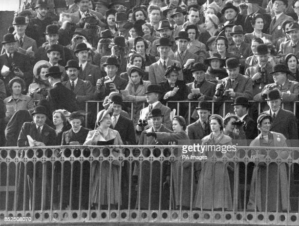 Royalty watching the Grand National at the top of Grandstand at Aintree Liverpool are Queen Elizabeth King George VI Princess Elizabeth Princess...
