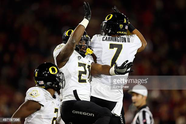 Royce Freeman and Darren Carrington of the Oregon Ducks celebrate after Freeman score a touchdown against the Stanford Cardinal at Stanford Stadium...