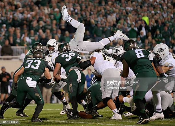 Royce Freeman of the Oregon Ducks is stopped as he dives for the end zone against the Michigan State Spartans during their game at Spartan Stadium on...