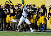 Royce Freeman of the Oregon Ducks makes a running catch during the fourth quarter against the Arizona State Sun Devils at Sun Devil Stadium on...