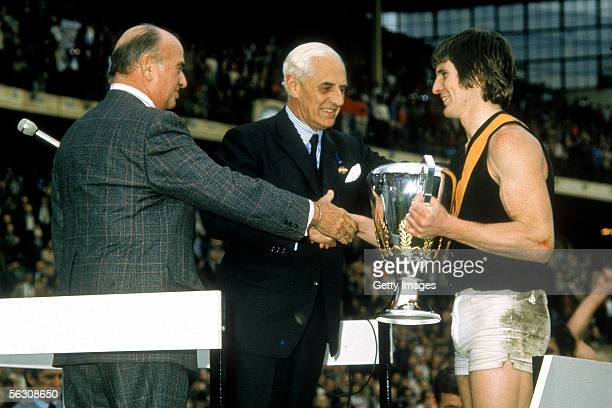 Royce Hart of the Tigers recieves the premiership cup after winning the VFL Grand Final between the Richmond Tigers and North Melbourne held at the...