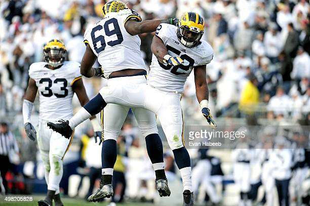 Royce JenkinsStone of the Michigan Wolverines celebrates with Willie Henry after a sack in the fourth quarter against the Penn State Nittany Lions at...