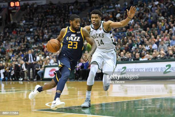 Royce O'Neale of the Utah Jazz is defended by Giannis Antetokounmpo of the Milwaukee Bucks during the first half of a game at the Bradley Center on...
