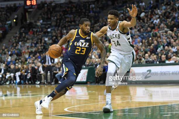 Royce O'Neale of the Utah Jazz is defended by Giannis Antetokounmpo of the Milwaukee Bucks during a game at the Bradley Center on December 9 2017 in...