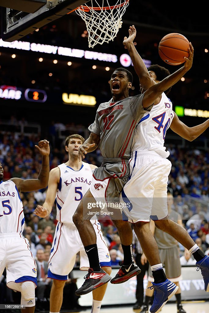 Royce Woolridge #22 of the Washington State Cougars drives as Kevin Young #40 of the Kansas Jayhawks defends during the CBE Hall of Fame Classic at Sprint Center on November 19, 2012 in Kansas City, Missouri.
