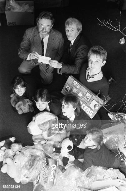 Royds Hall High School head Peter Clarkson presenting ø40 cheque to NSPCC for their Christmas toy appeal 19th December 1985Royds Hall High School...