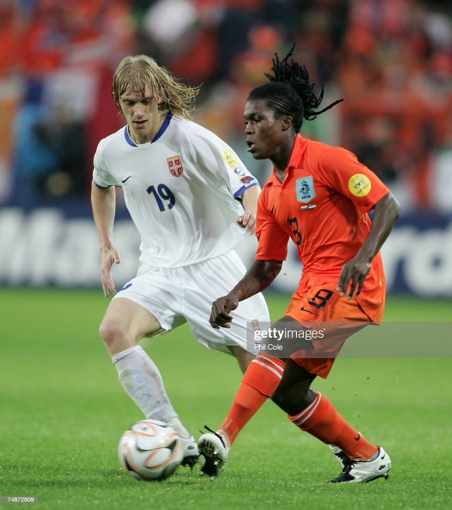 Royston Drenthe of the Netherlands gets tackled by Dusan Basta of Serbia during the UEFA European Under21 Championship Final match between the...