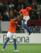 Royston Drenthe of the Netherlands is thrown into the air by his team mate Ryan Donk as they celebrate their victory during the UEFA U21 Championship...