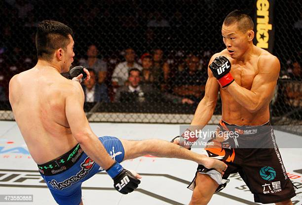 Royston Wee of Singapore kicks Ning Guangyou of China in their bantamweight fight during the UFC Fight Night event at the Mall of Asia Arena on May...