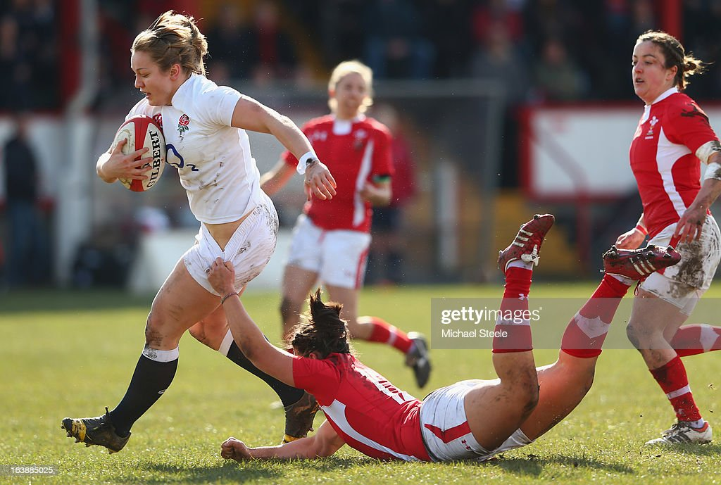 Roz Crowley (L) of England is held up by Rebecca De Filippo (R) of Wales during the Wales v England Womens Six Nations match at the Talbot Athletic Ground on March 17, 2013 in Port Talbot, Wales.