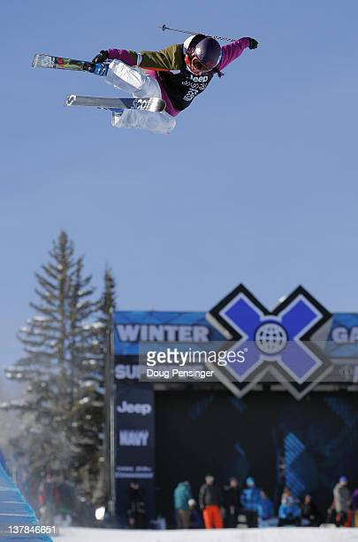Roz Groenewoud of Canada soars above the pipe as she warms up for the women's ski superpipe finals during Winter X Games 2012 at Buttermilk Mountain...