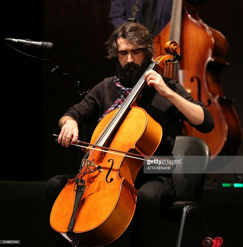 Rozbeh Sfardarmarz, musician for Iranian pop singer Omid Nemati, performs on stage during the 31th Fajr International Music Festival in the capital Tehran, on February 13, 2016. / AFP / ATTA KENARE