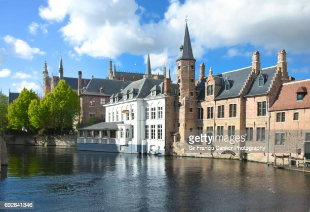 Rozenhoedkaai waterfront and canal view with medieval civil architecture samples in Bruges, Flanders
