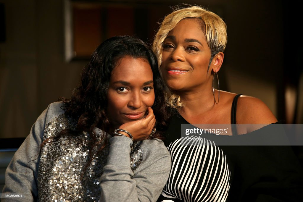 Rozonda 'Chilli' Thomas and Tionne 'TBoz' Watkins of American girl group 'TLC' pose during a photo shoot at the Four Seasons Hotel on June 5 2014 in...