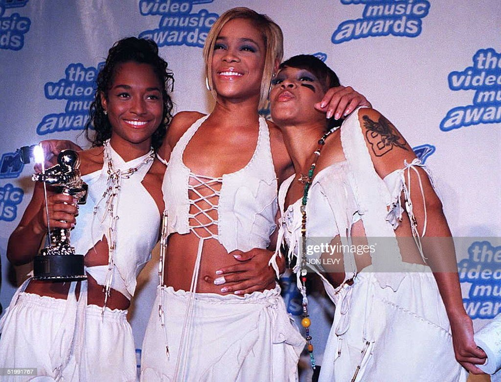 Rozonda 'Chilli' Thomas Tionne 'TBoz' Watkins and Lisa 'Left Eye' Lopes of the group TLC pose with their award for Best Video of the Year 07...