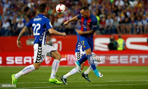 rPaco Alcacer of Barcelona and Vigaray of Alaves battle for the ball during the Copa Del Rey Final between FC Barcelona and Deportivo Alaves at...