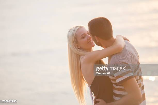 Rpmantic couple embracing by the sea