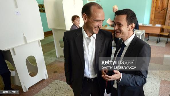 RPRParnas opposition party candidates Vladimir Andreichenko and Ilya Yashin speak at a polling station during Russian regional elections in the town...