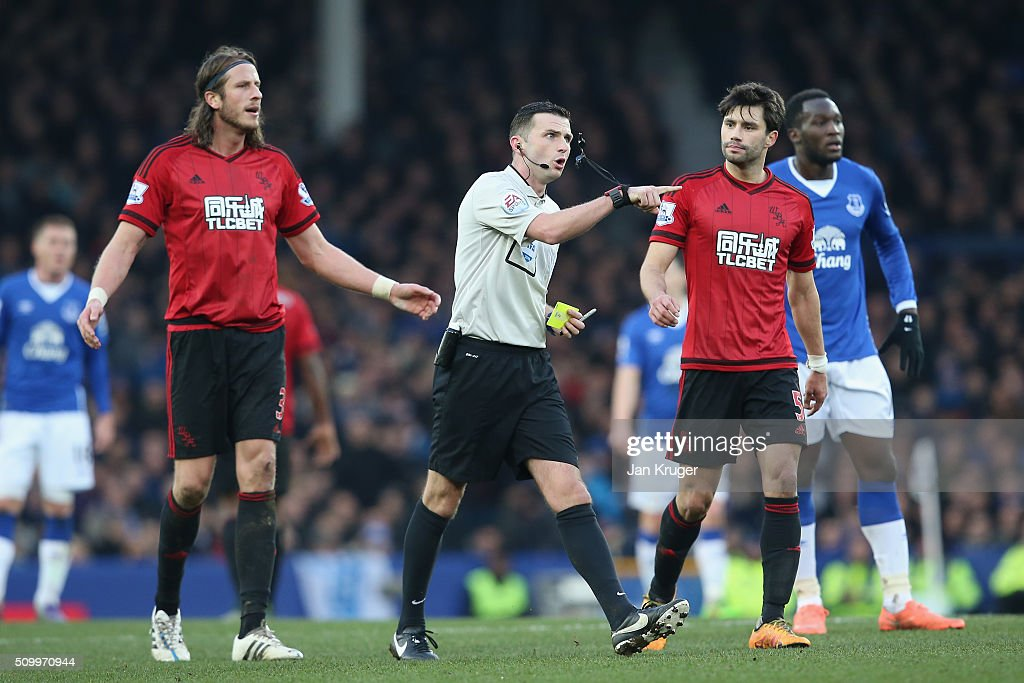 Rreferee <a gi-track='captionPersonalityLinkClicked' href=/galleries/search?phrase=Michael+Oliver+-+Soccer+Referee&family=editorial&specificpeople=14095035 ng-click='$event.stopPropagation()'>Michael Oliver</a> walks before showing an yellow card to Ben Foster (not pictured) during the Barclays Premier League match between Everton and West Bromwich Albion at Goodison Park on February 13, 2016 in Liverpool, England.