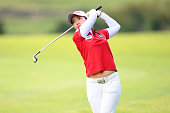 Rtisuko Ryu of Japan hits her second shot on the 1st hole during the final round of the Century 21 Ladies Golf Tournament 2016 at the Izu Daijin...