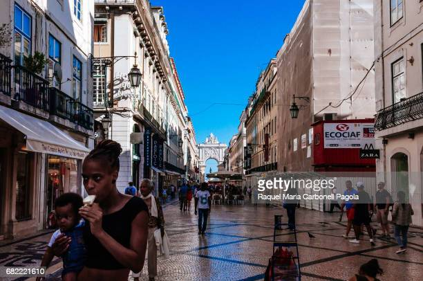 Rua Augusta with its great stone arch at back is Lisbon's main pedestrian street with mosaic pavements cafes and international shops