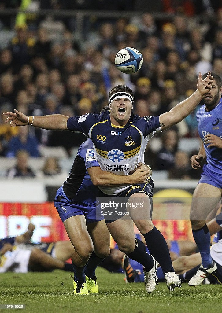 Ruaidhri Murphy of the Brumbies is tackled during the round 11 Super Rugby match between the Brumbies and the Force at Canberra Stadium on April 27, 2013 in Canberra, Australia.