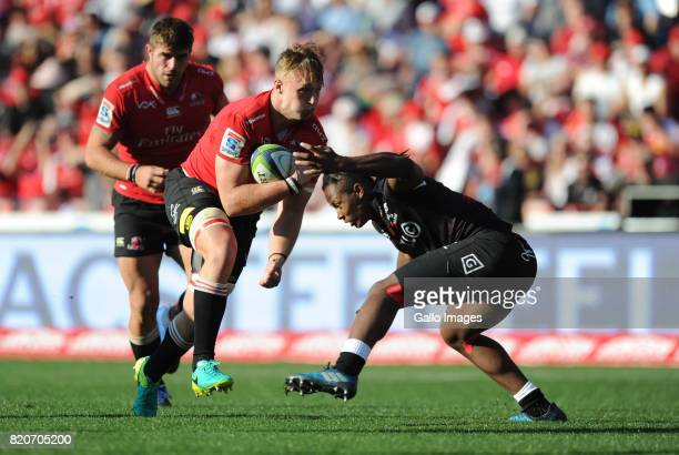 Ruan Ackermann of Lions is tackled by Sbu Nkosi of Sharks during the Super Rugby Quarter final between Emirates Lions and Cell C Sharks at Emirates...