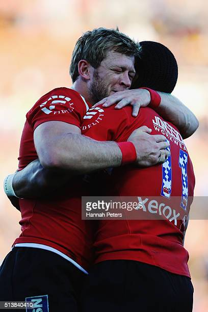 Ruan Combrinck of the Lions celebrates with Courtnal Skosan of the Lions after winning the round two Super Rugby match between the Chiefs and the...