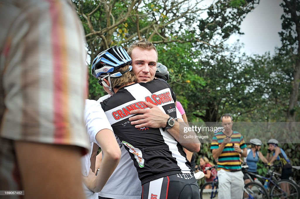 Ruan Nagel, best friend to the late Burry Stander, is comforted at the sight of the accident, where Burry Stander lost his life, on January 6, 2013 in Balito, South Africa. Burry was hit by a taxi while out on a training ride, he suffered severe head trauma and a broken neck, he was killed on impact. The taxi driver has been charged with culpable homicide.