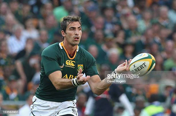 Ruan Pienaar of South Africa passes the ball during the Rugby Championship match between South Africa Springboks and the New Zealand All Blacks at...