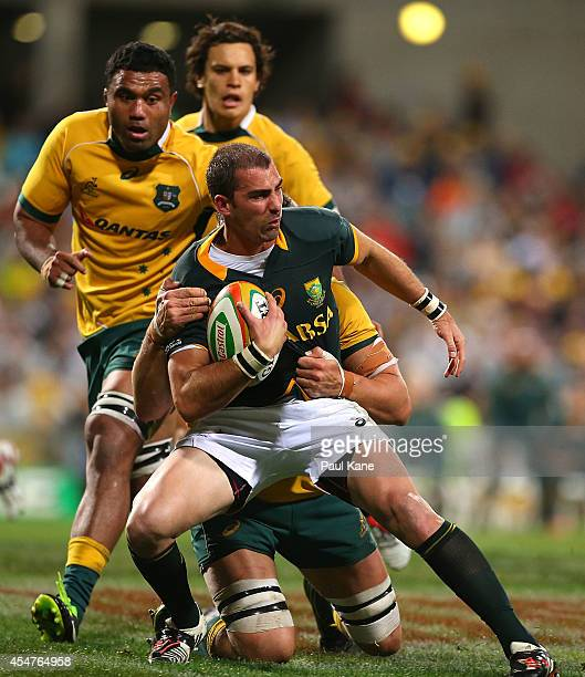 Ruan Pienaar of the Springboks gets tackled during The Rugby Championship match between the Australian Wallabies and the South African Springboks at...