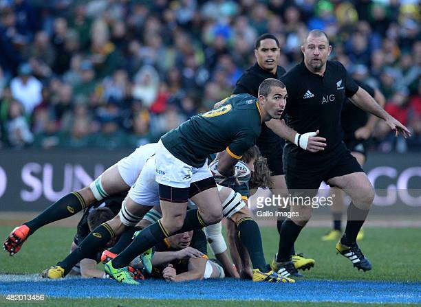 Ruan Pienaar passes during The Castle Lager Rugby Championship 2015 match between South Africa and New Zealand at Emirates Airline Park on July 25...