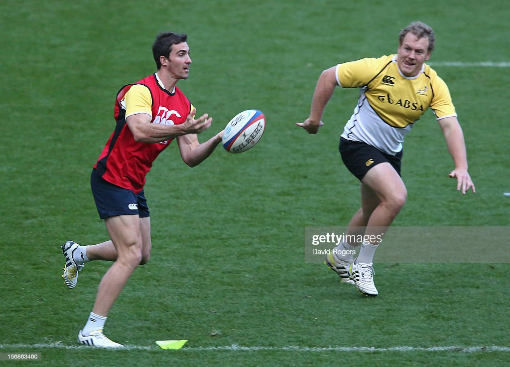 <a gi-track='captionPersonalityLinkClicked' href=/galleries/search?phrase=Ruan+Pienaar&family=editorial&specificpeople=591032 ng-click='$event.stopPropagation()'>Ruan Pienaar</a> passes the ball during the South Africa Springboks captain's run at Twickenham Stadium on November 23, 2012 in London, England.
