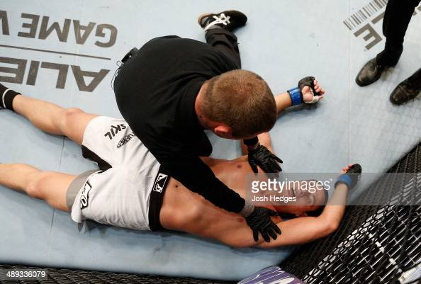 Ruan Potts lays on the canvas after his knockout loss to Soa Palelei in their heavyweight fight during the UFC Fight Night event at the US Bank Arena...
