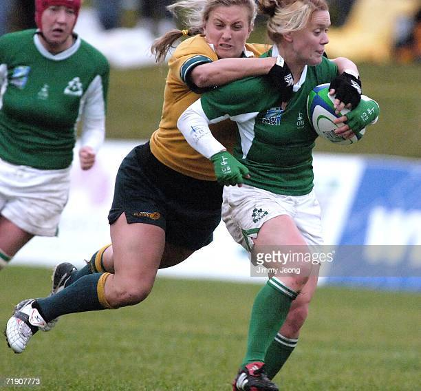 Ruan Sims of Australia tries to tackle Ireland's Lynne Cantwell during day five of the Women's Rugby World Cup 2006 at Ellerslie Rugby Football Club...