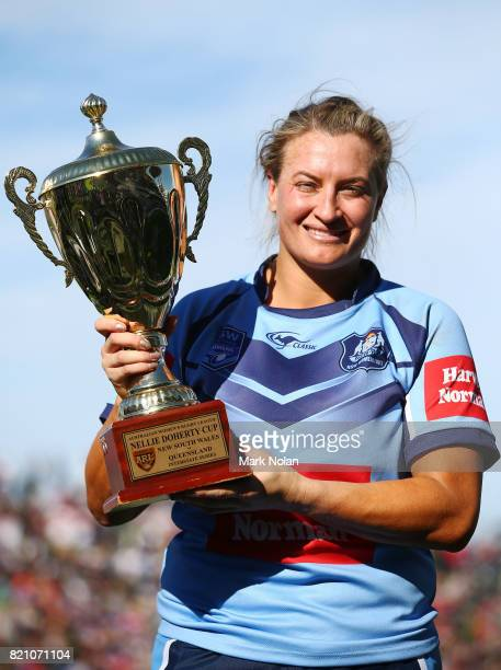Ruan Sims of NSW is pictured with the trophy after winning the Women's Interstate Challenge match between New South Wales and Queensland at WIN...