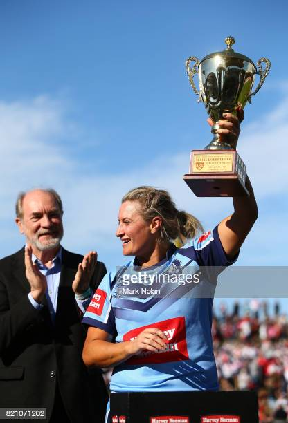 Ruan Sims of NSW is presented with the trophy after NSW won the Women's Interstate Challenge match between New South Wales and Queensland at WIN...