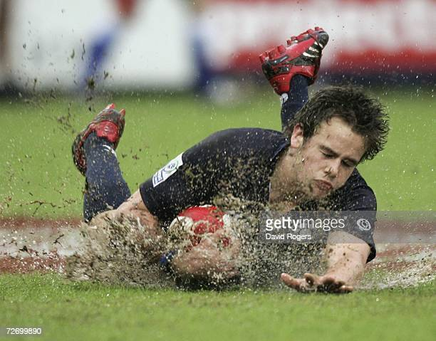 Ruaridh Jackson of Scotland dives in the mud to score a try against Wales during the Emirates IRB Dubai Sevens held at the Exiles Club on December 2...