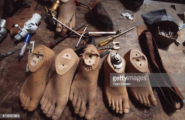 Rubber artificial feet and tools at a workshop producing prosthetic limbs just outside Bangkok