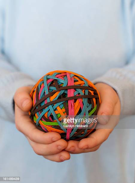 Rubber Band Ball Held in Hands