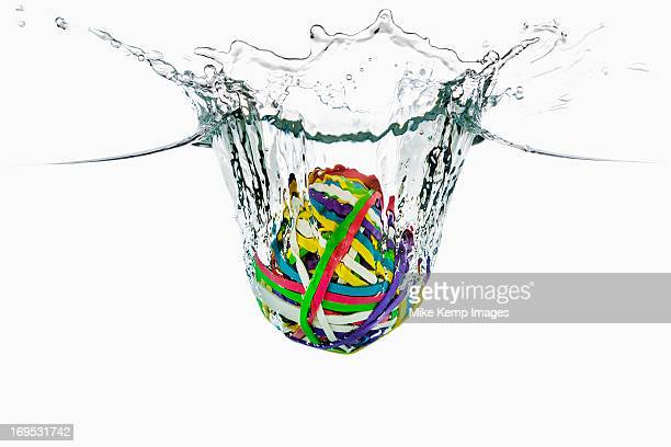 Rubber band ball splashing into water
