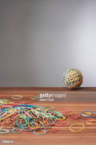 Rubber bands and ball on desk