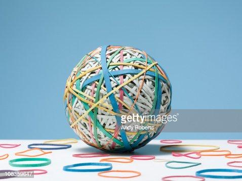 Rubber bands surrounding rubber band ball