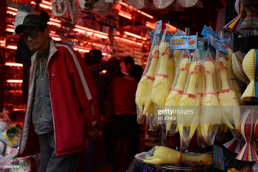 Rubber chickens are displayed at a shop in Beijing on April 18, 2013. China has confirmed a total of 82 human cases of H7N9 avian influenza since announcing about two weeks ago that it had found the strain in people for the first time. AFP PHOTO / Ed Jones