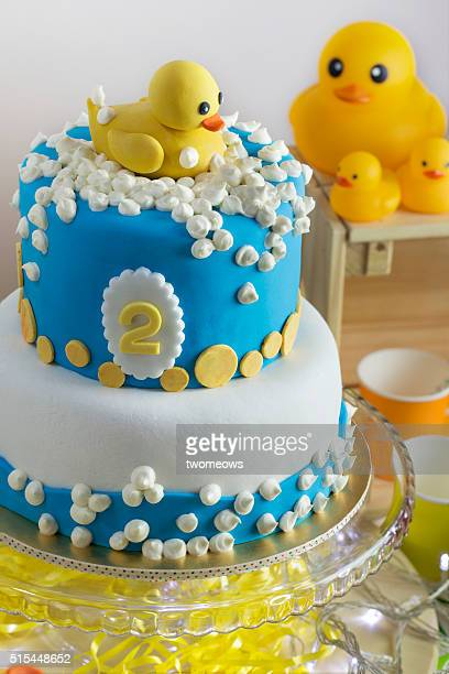 Rubber duck theme kids or children birthday cake party table top shot.