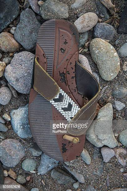 Rubber flipflop with leather and beaded embelishments found near Eftalou on the island of Lesbos Shoes found on the beaches and around the Greek...
